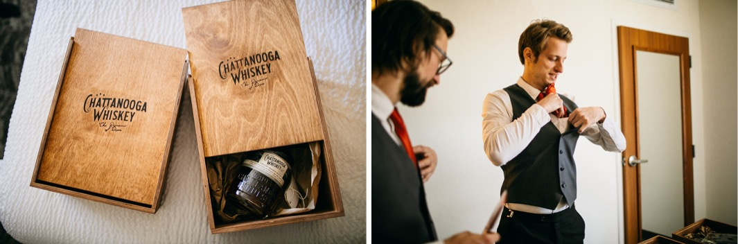 groomsmen getting dressed with bottle of Chattanooga Whiskey beside them