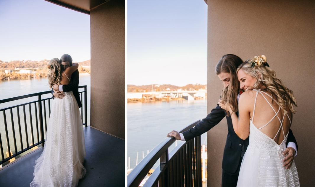 bride and groom hug on a porch overlooking the Tennessee River in Chattanooga