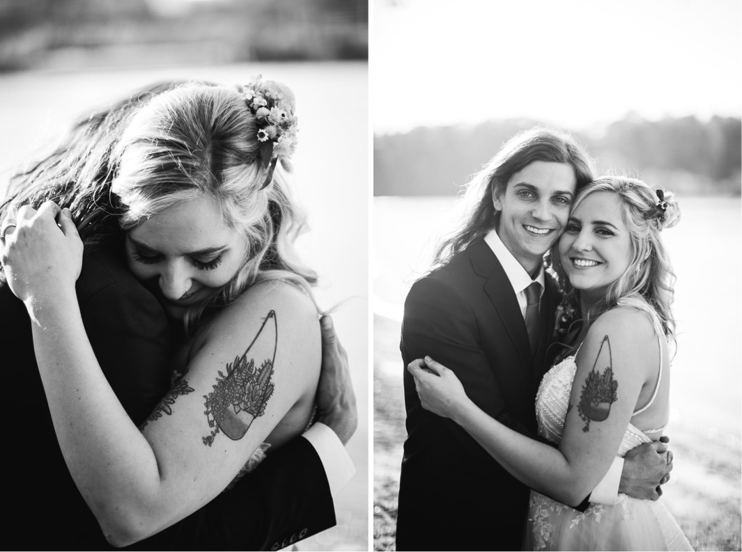 bride and groom hug on the bank of the Tennessee River