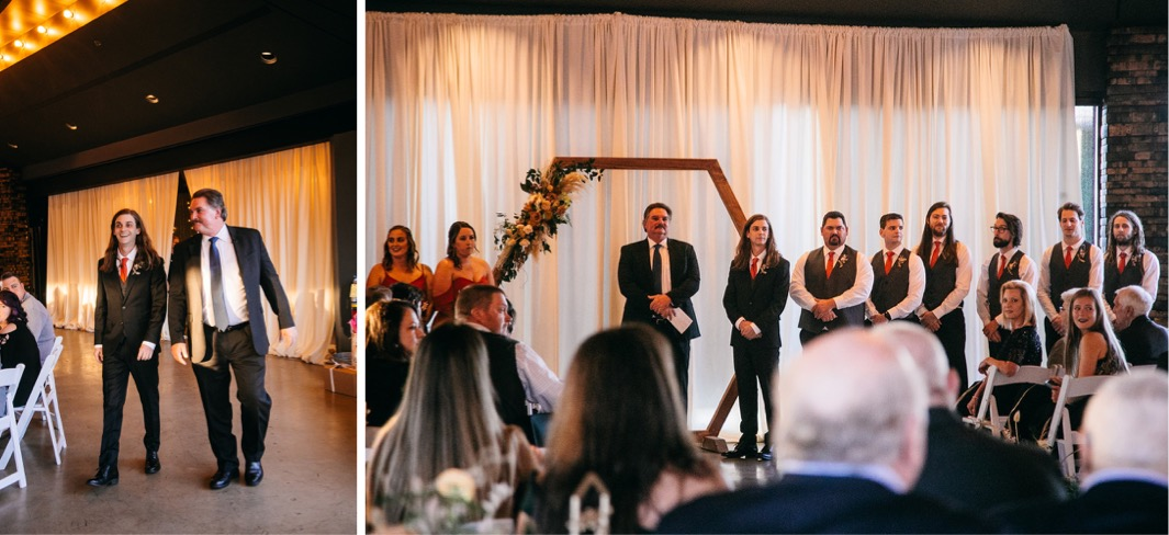 bridal party stands with officiant under wedding arch at Chattanooga Whiskey Distillery Wedding
