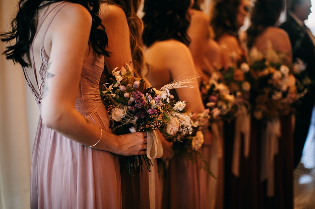bridesmaids hold wild, organic Southerly Flower Farm bouquets