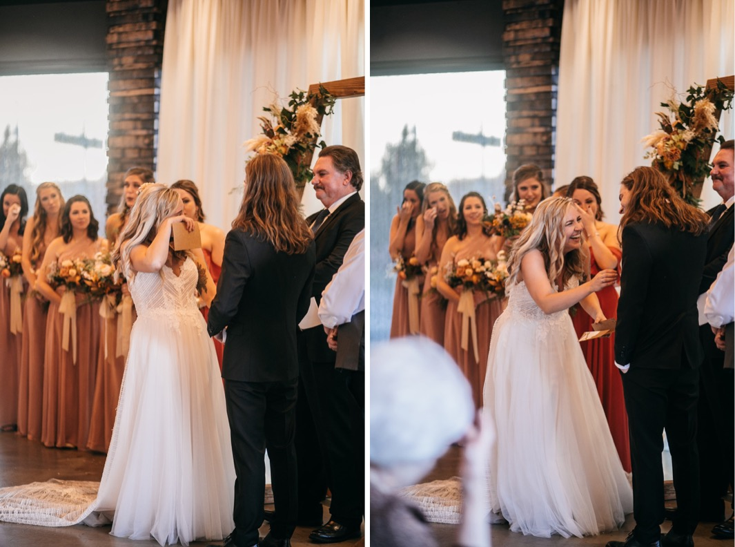 bride laughs while groom reads his wedding vows to her
