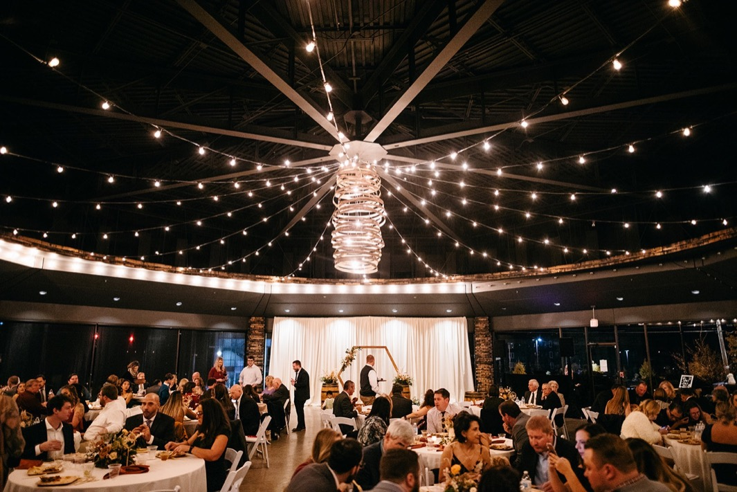 round reception space of Chattanooga Whiskey Event Hall lit with white string lights