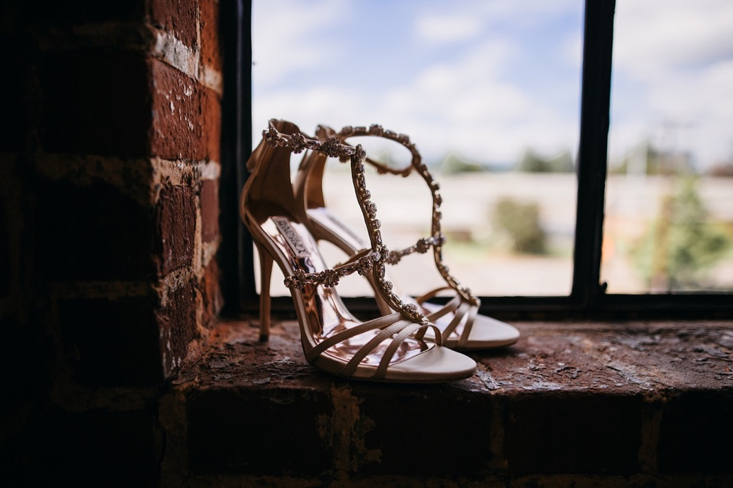 A close up detail shot of the brides tan high heels with rhinestones