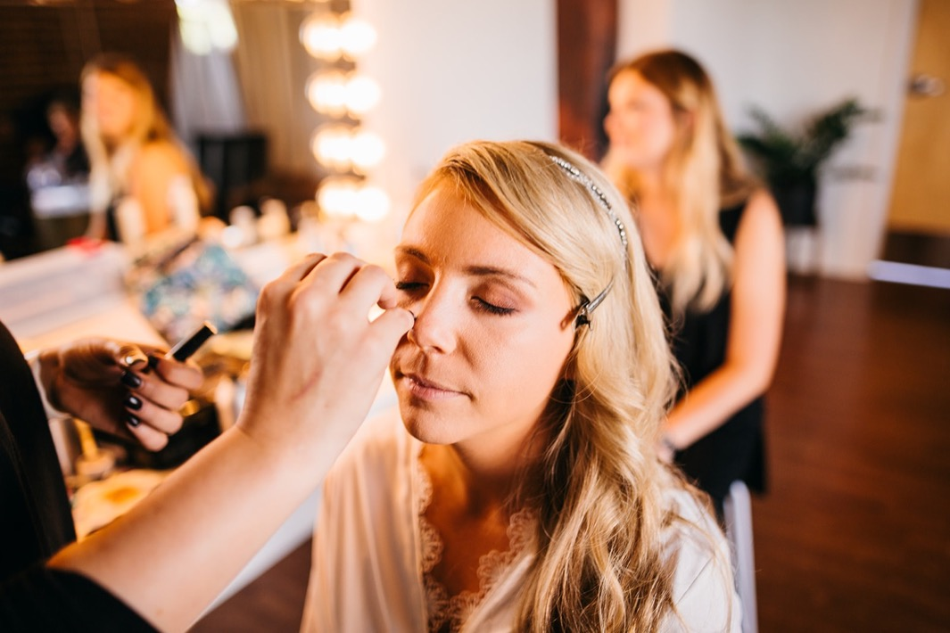 Bride having her makeup put on before her wedding at the Turnbull building