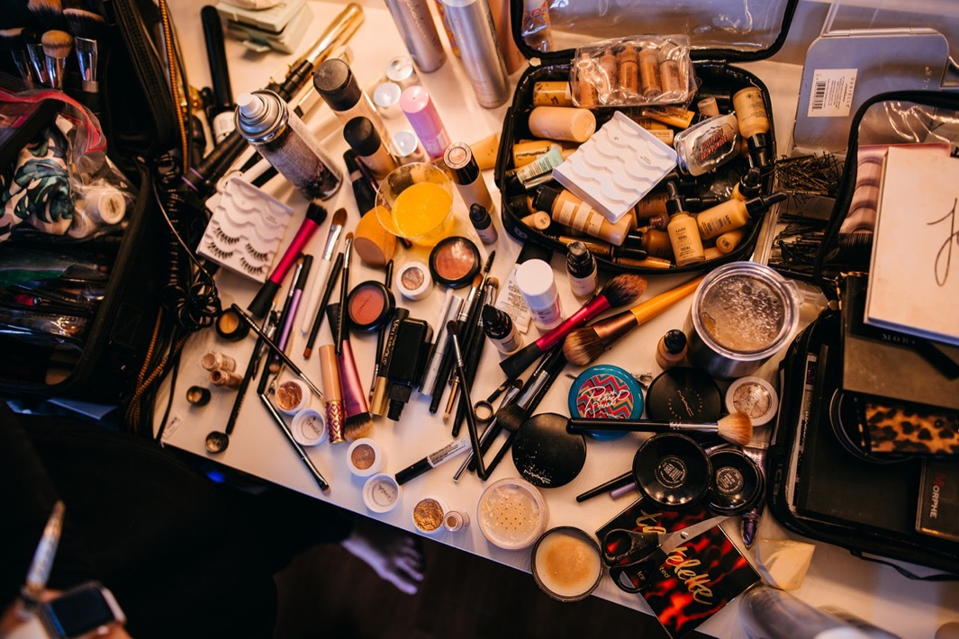A shot of the beauty station with all the makeup laid out