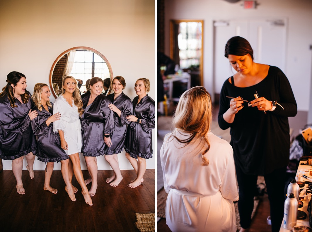 Bride stands with her bridesmaids for a photo in their robes before the wedding at the Turnbull building