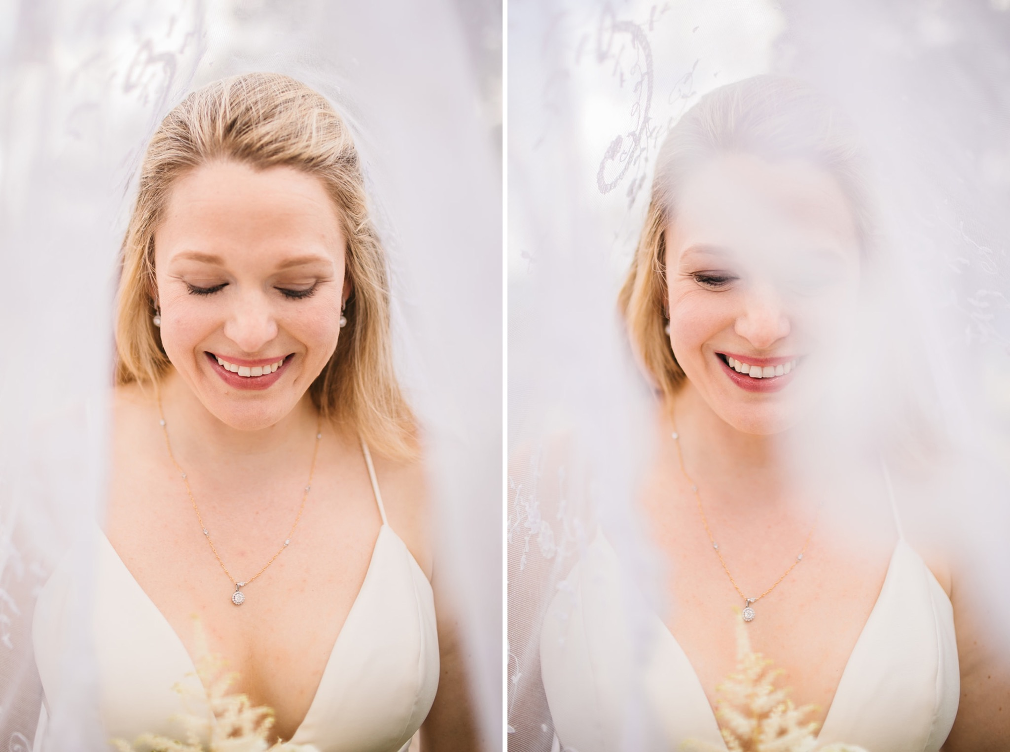 bride smiles down at her bouquet with her lace veil surrounding her