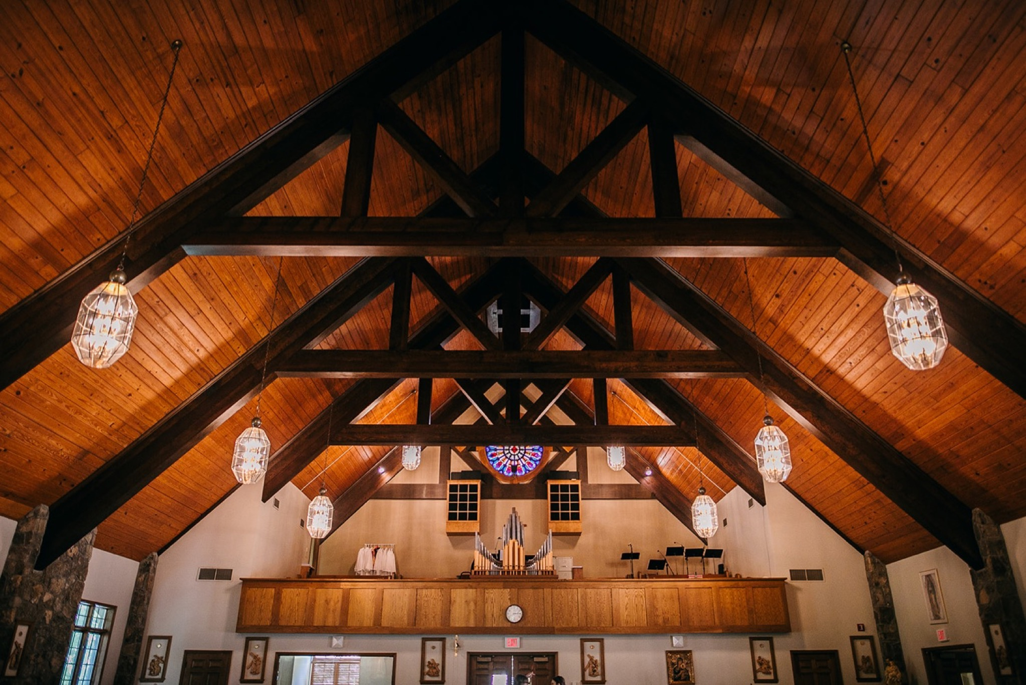 peaked wooden ceiling and large wooden rafters inside Our Lady of the Mount Catholic Church on Lookout Mountain