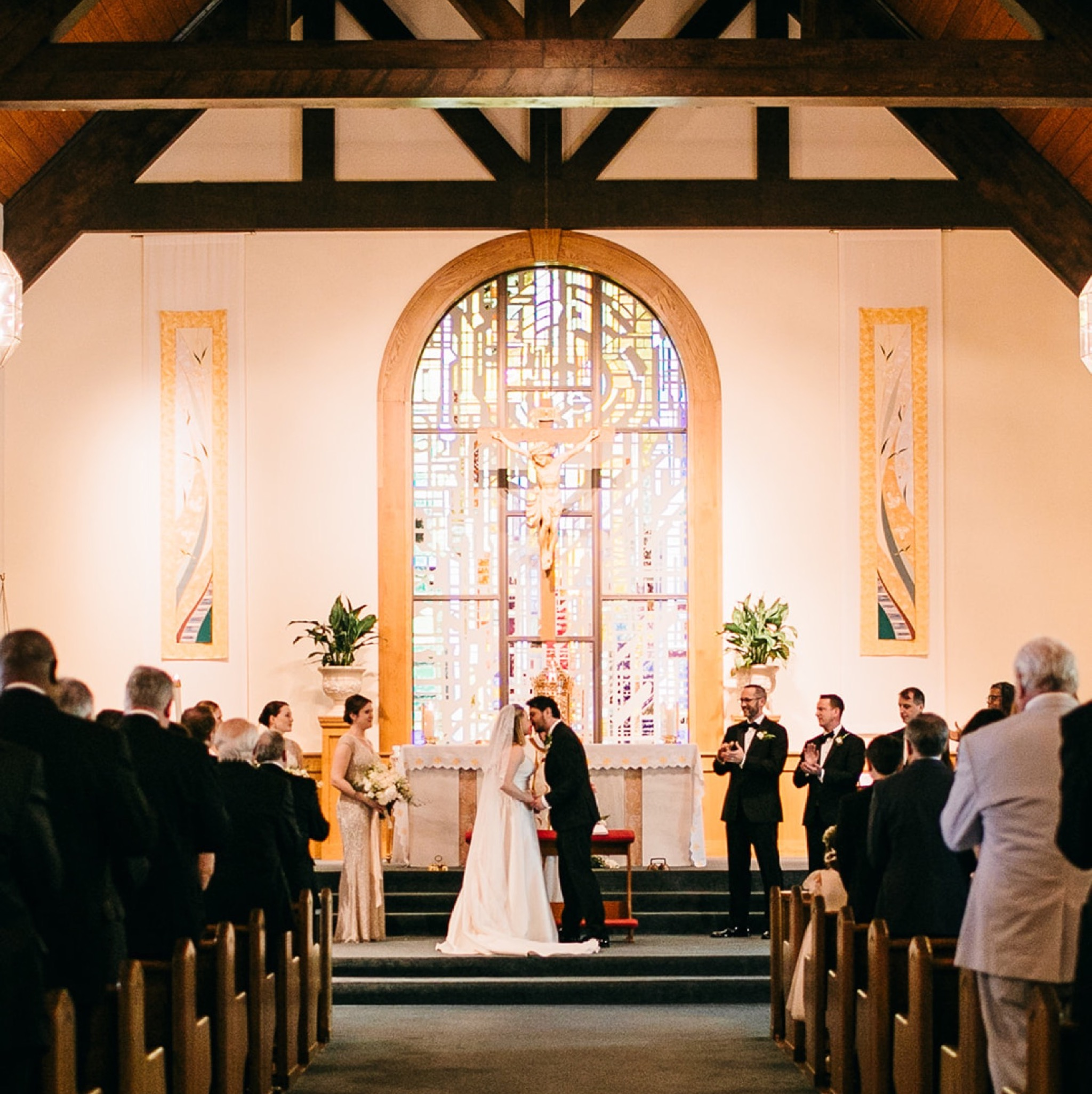 bride and groom kiss at the altar of Our Lady of the Mount Catholic Church on Lookout Mountain near Chattanooga