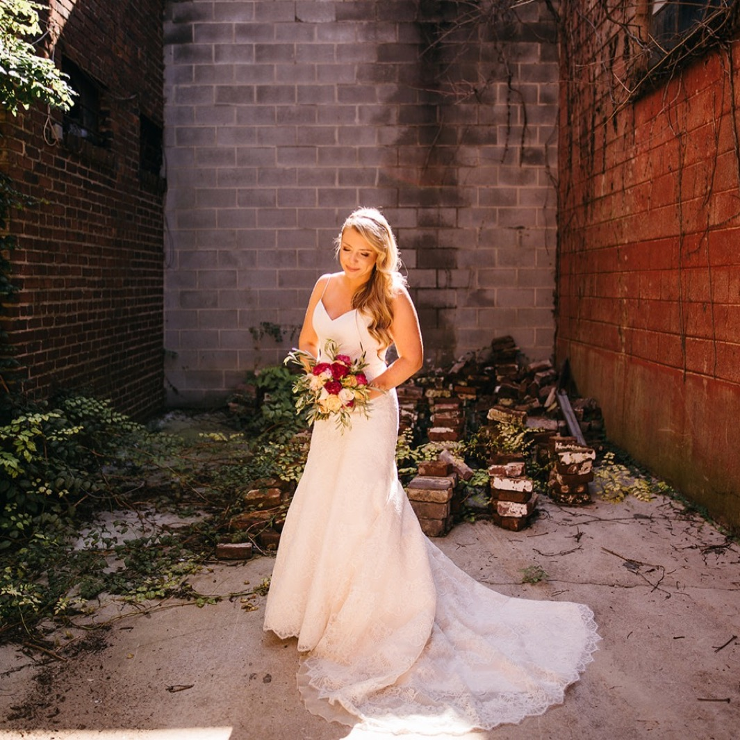Bride holds her bouquet as she stands outside the Turnbull building wedding.