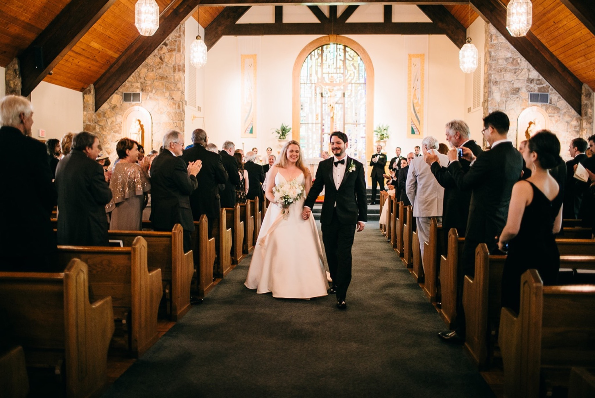 bride and groom walk down the aisle of Our Lady of the Mount Catholic Church on Lookout Mountain near Chattanooga