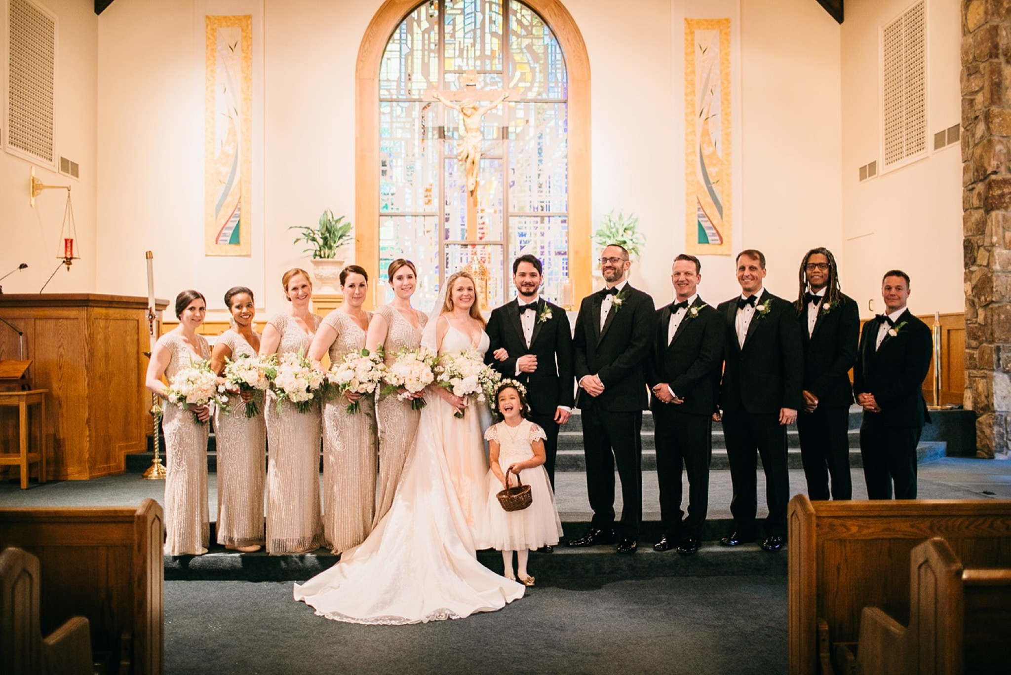 bridal party stands at the altar of Our Lady of the Mount Catholic Church near Chattanooga, TN