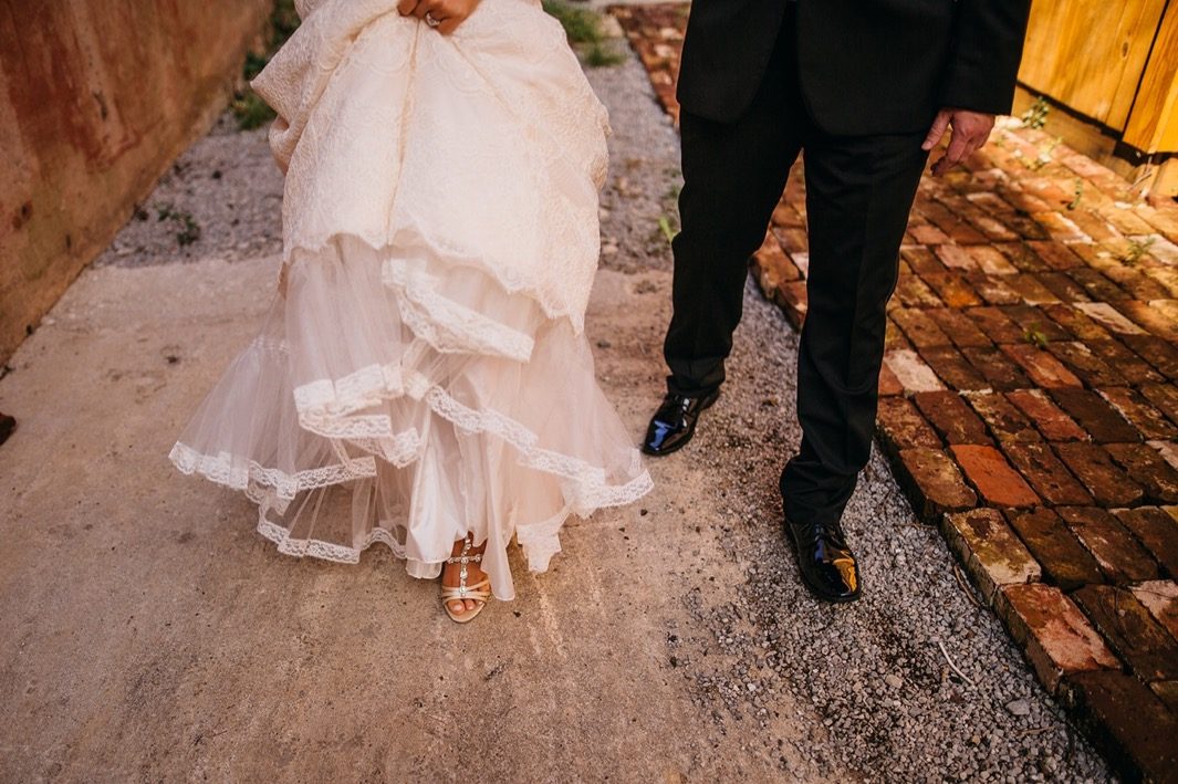 Close up of the bride and grooms shoes as they walk outside the wedding at the Turnbull building.