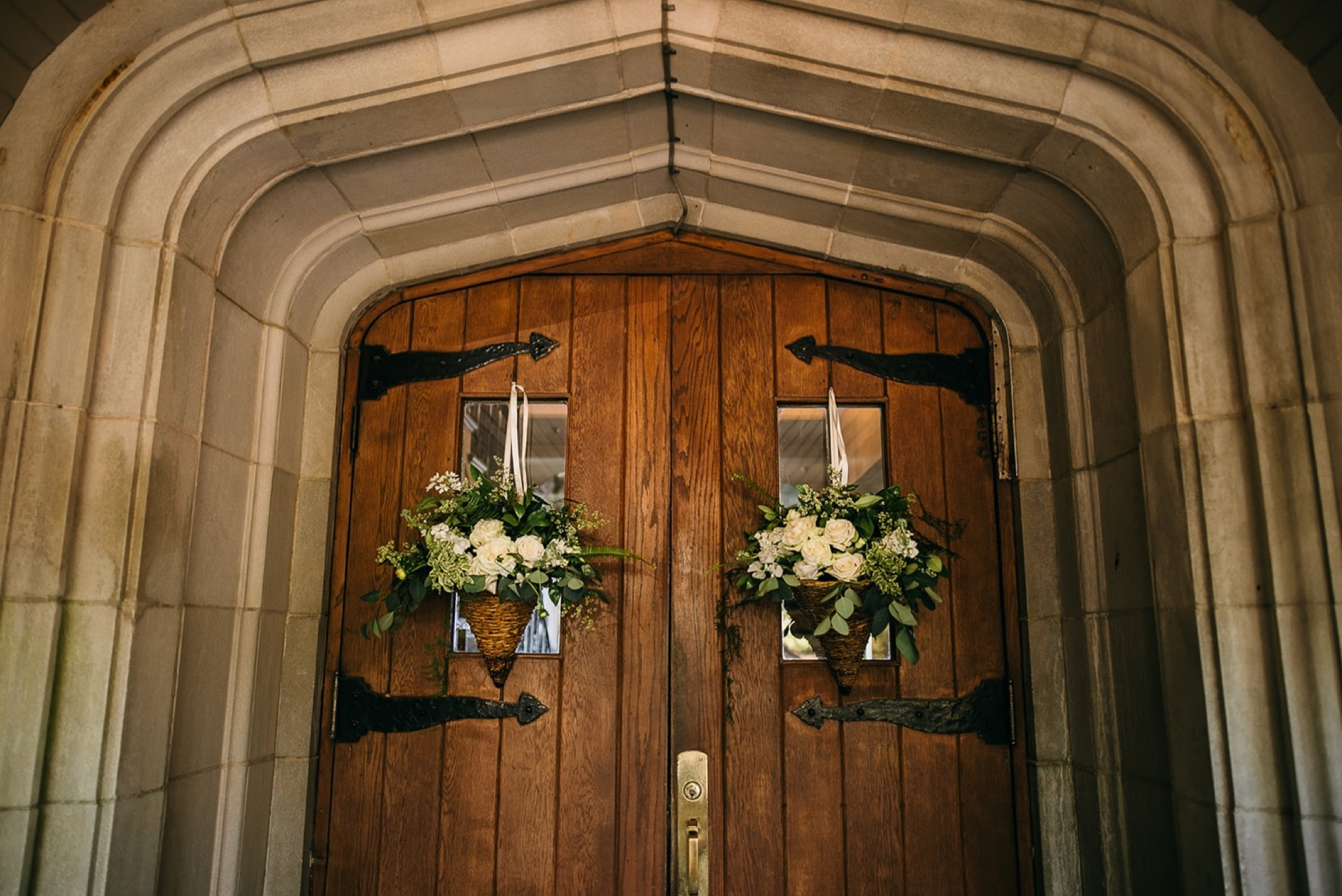 Lookout Mountain Club entrance wooden doors nestled in stone archway