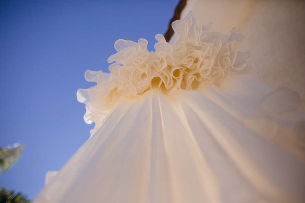 ruffled hem of hanging wedding dress