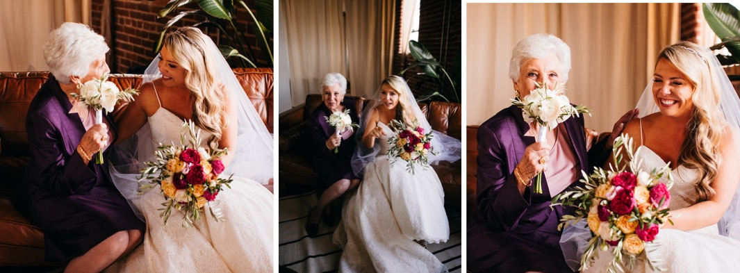 Bride sits on a love seat with her grandma smiling and laughing as the hold their bouquets for the wedding at the Turnbull building.