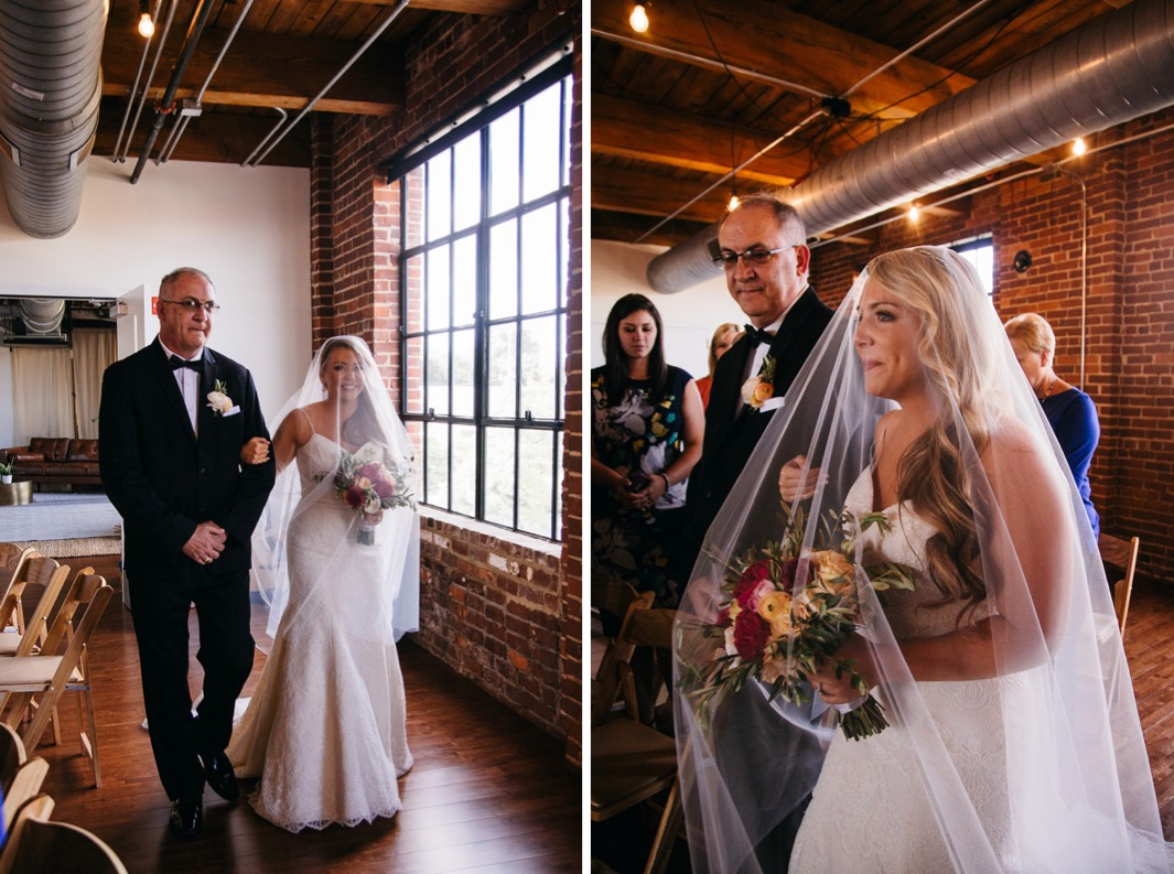 Bride walks down the aisle with her father as he smiles at her during her wedding at the Turnbull building.