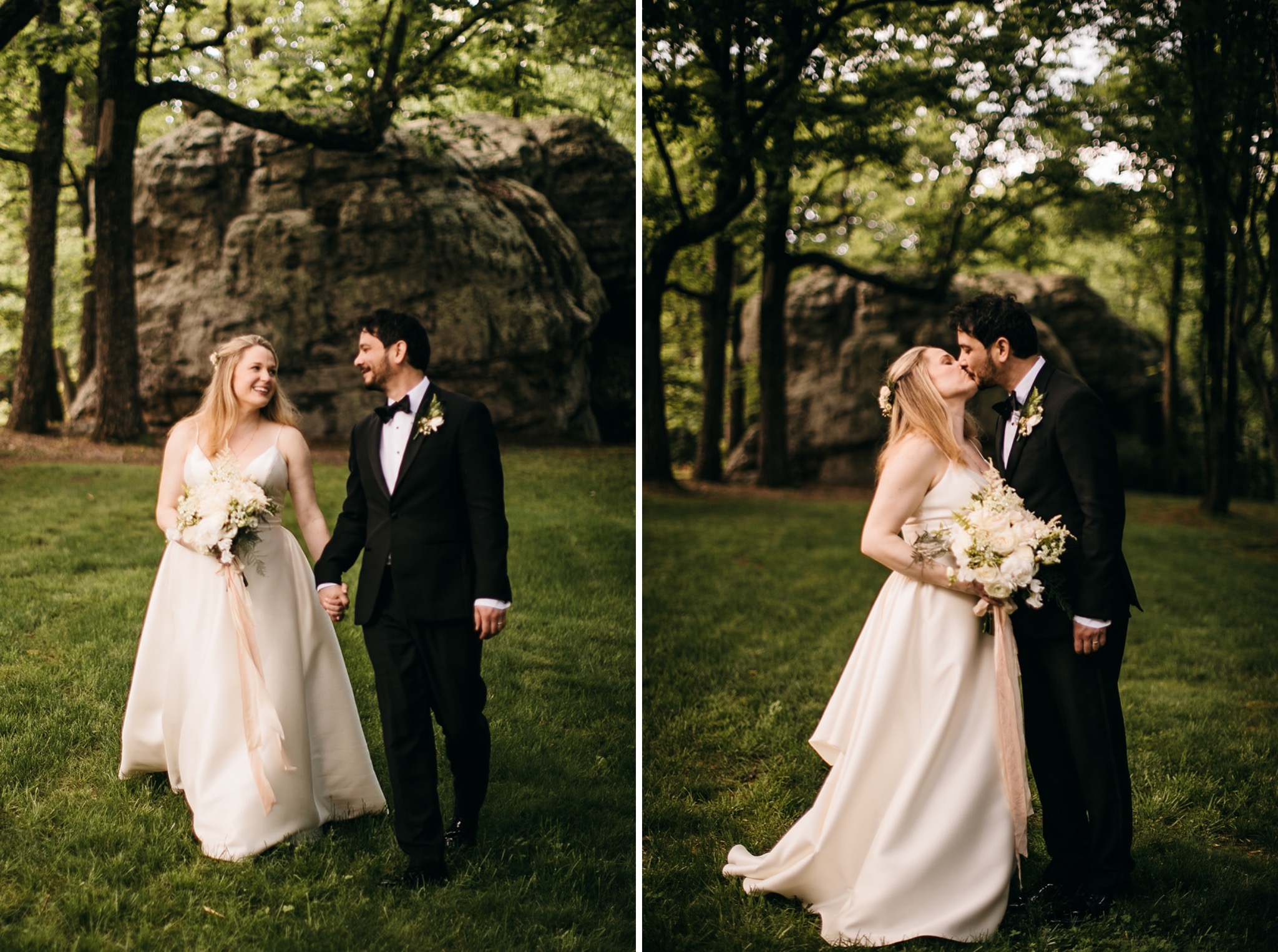 bride and groom kiss in grassy field near large rocks at Lookout Mountain Club wedding reception