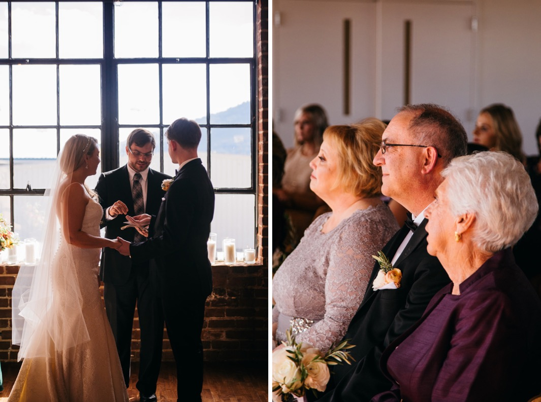 Bride and groom look at the officiant as he hands the groom a ring during their wedding at the Turnbull building.