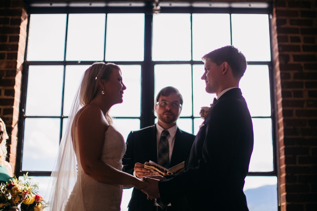 Bride and groom exchange vows to each other during their wedding at the Turnbull building.