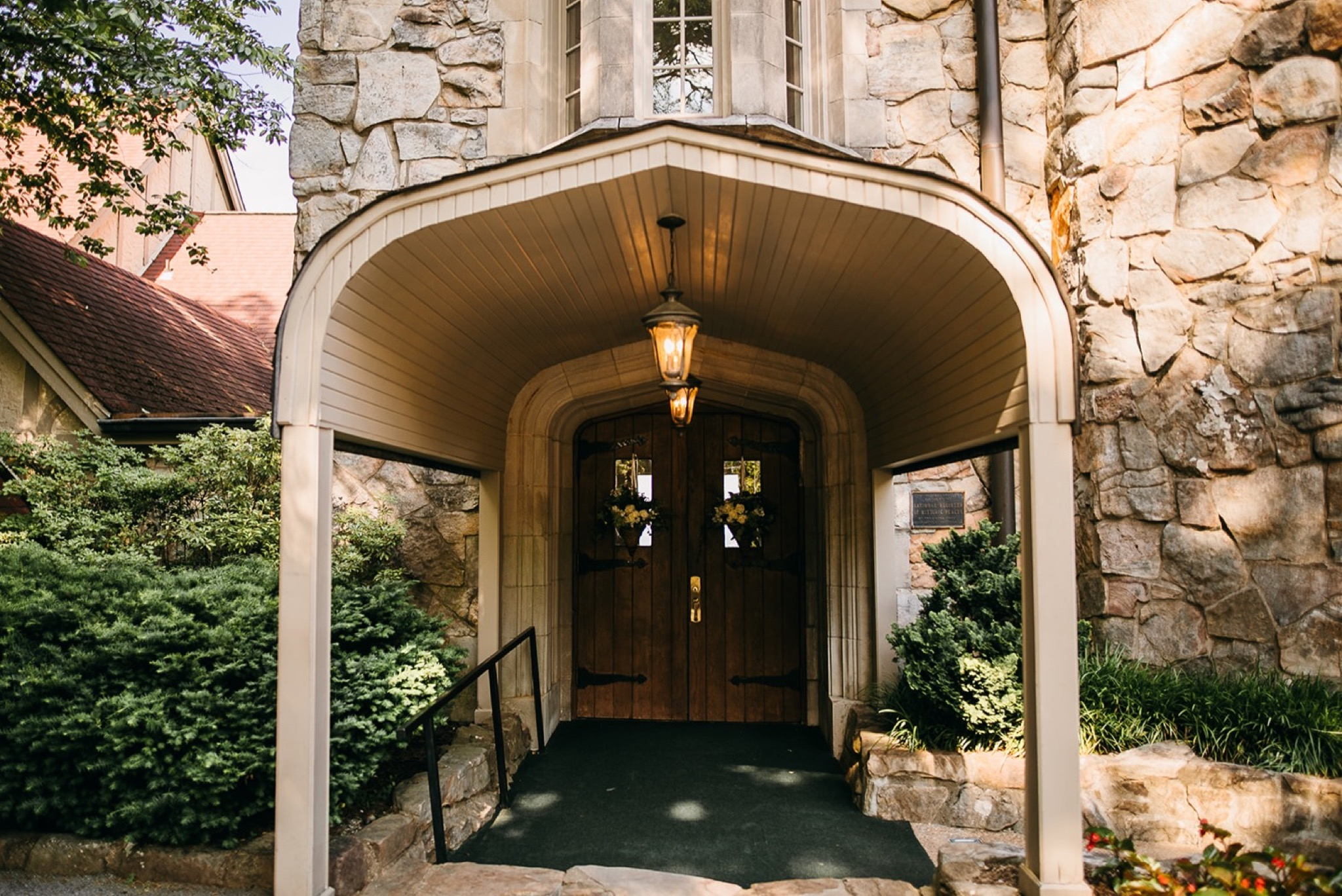 covered walkway and wooden double door entrance to Lookout Mountain's Fairyland Club