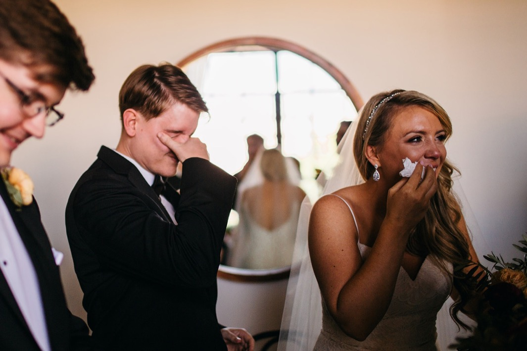 Bride and groom laugh through tears at their Turnbull building wedding.