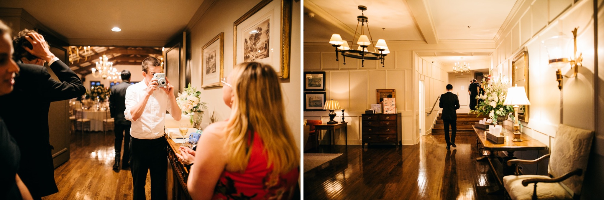 man photographs a woman in a red dress in Lookout Mountain Club's entry hallway