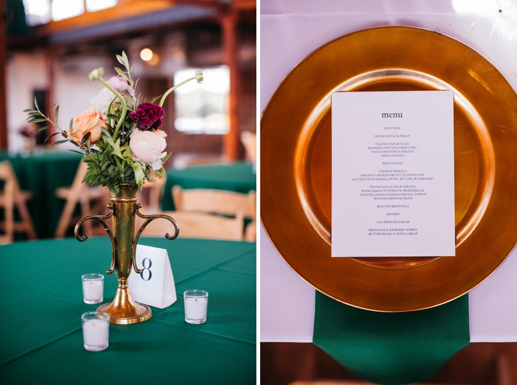 White peach and pink roses sit in a gold vase as a centerpiece on the table at the reception of the wedding at the Turnbull building. The wedding menu lays on top of a gold plate.
