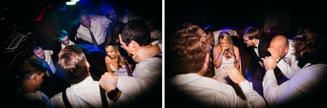 Bride and groom stand in a circle on the dance floor as they dance at the wedding in the Turnbull building.