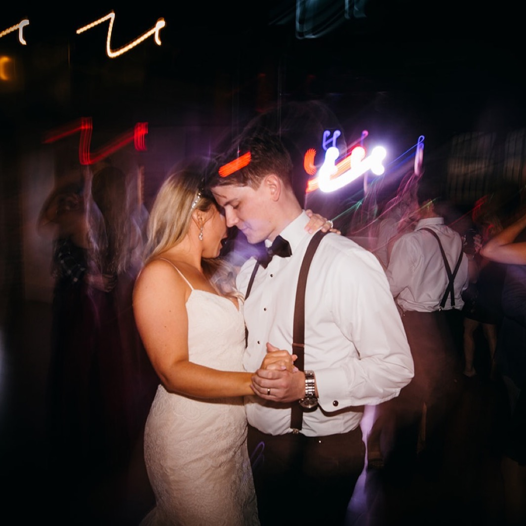 Bride and groom share a final dance at their wedding at the Turnbull building.
