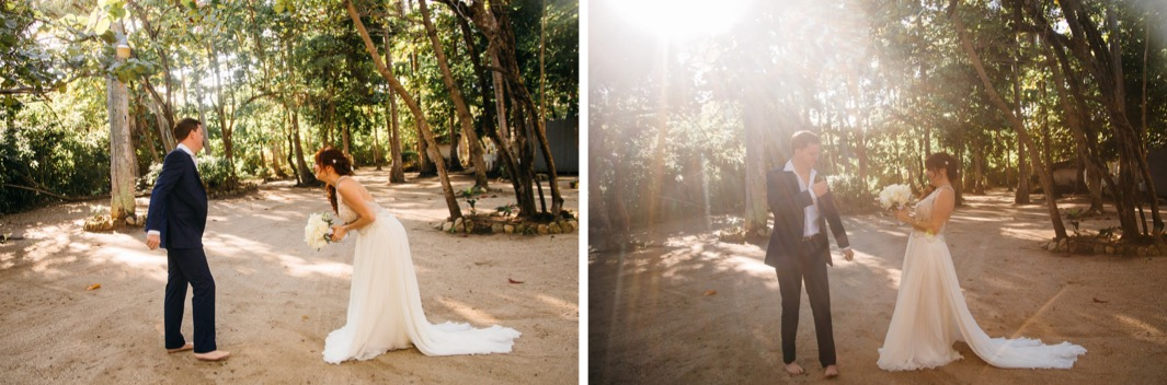 barefoot groom in suit turns to see his bride in her gown for their first look