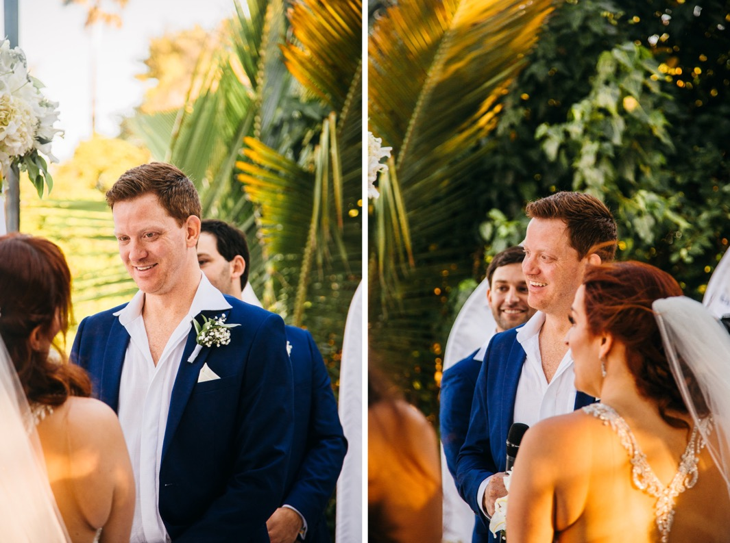 groom smiles at bride while officiant reads as they elope in the Dominican Republic