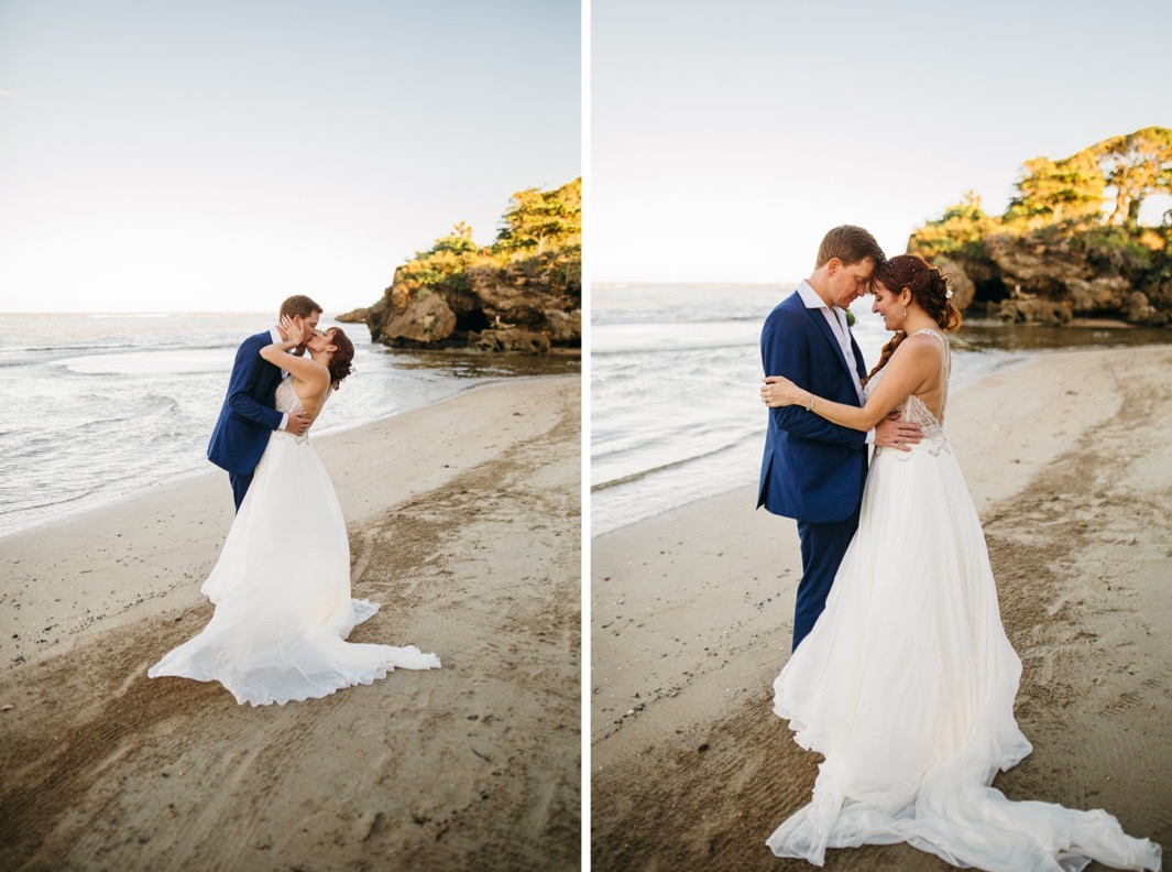 groom in blue suit kisses bride in white sequined gown on beach after they elope in the Dominican Republic