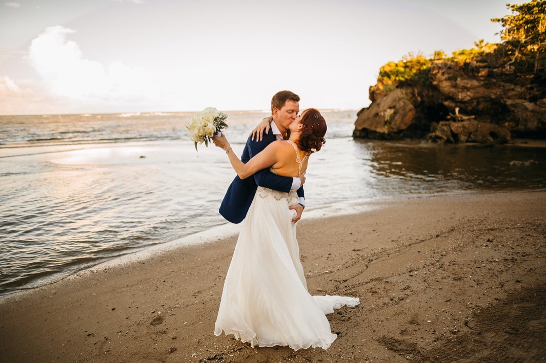 bride and groom kiss on private beach after they elope in the Dominican Republic