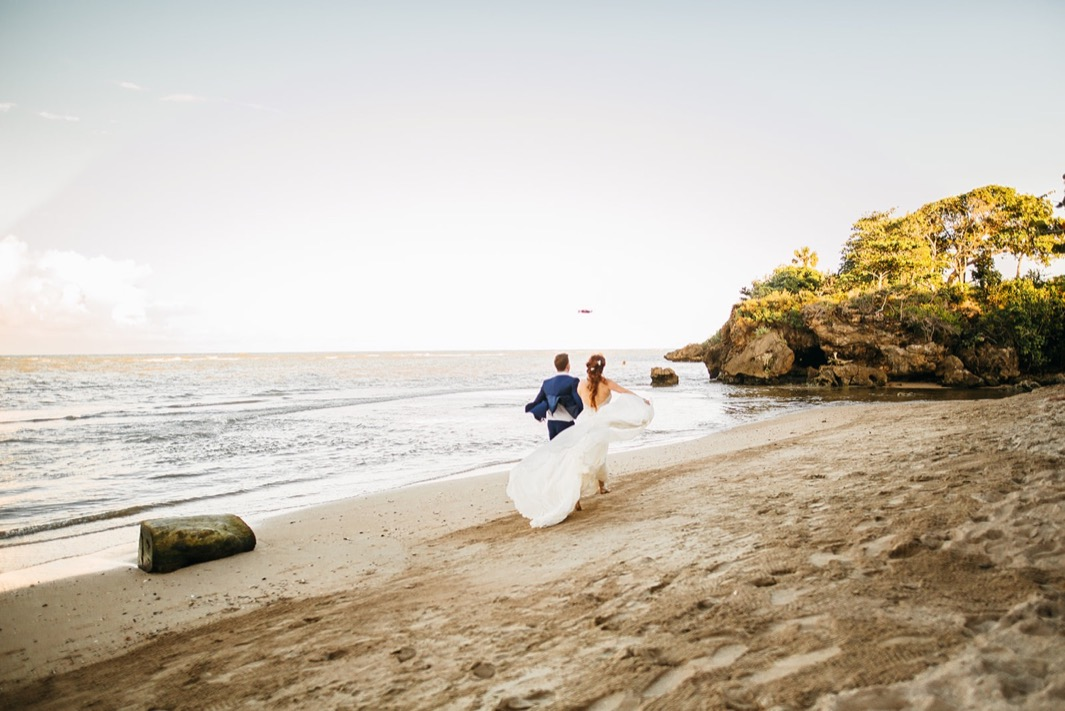 bride and groom walk on private beach after they elope in the Dominican Republic