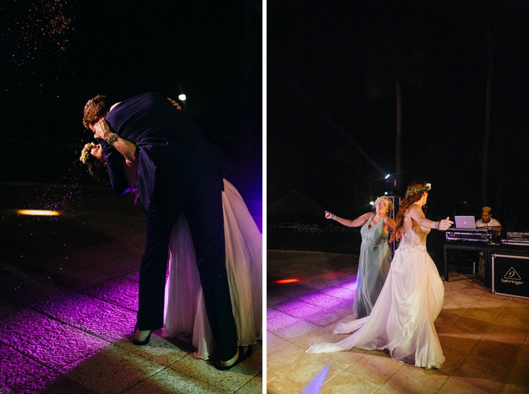 groom dips bride for a kiss on the dance floor while guests shower them with confetti