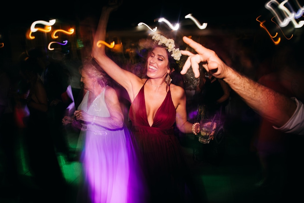 wedding guests dance in the dark