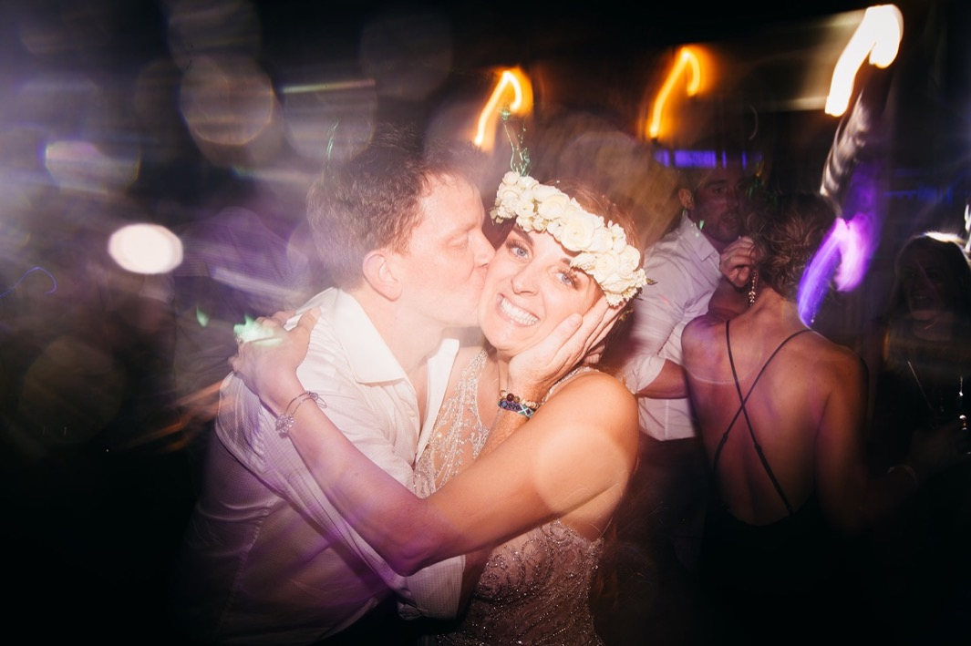 groom kisses brides cheek during their Dominican Republic elopement reception party