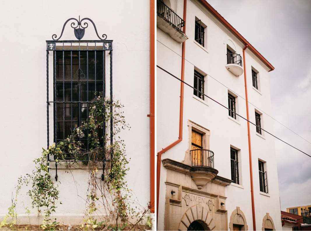 whitewashed exterior of Common House Chattanooga with ivy growing through wrought iron window bars