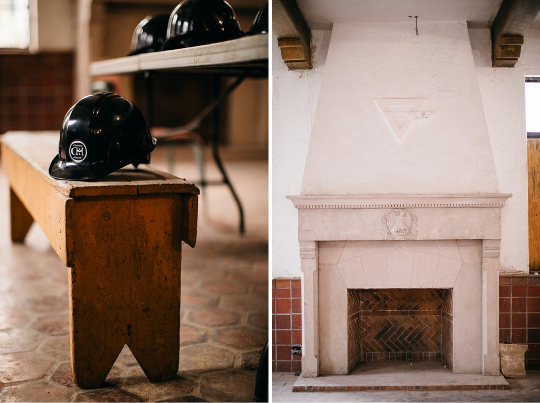 wooden bench and hard hat on hexagon tile floors in Common House Chattanooga's Pennybacker Room in front of plaster fireplace