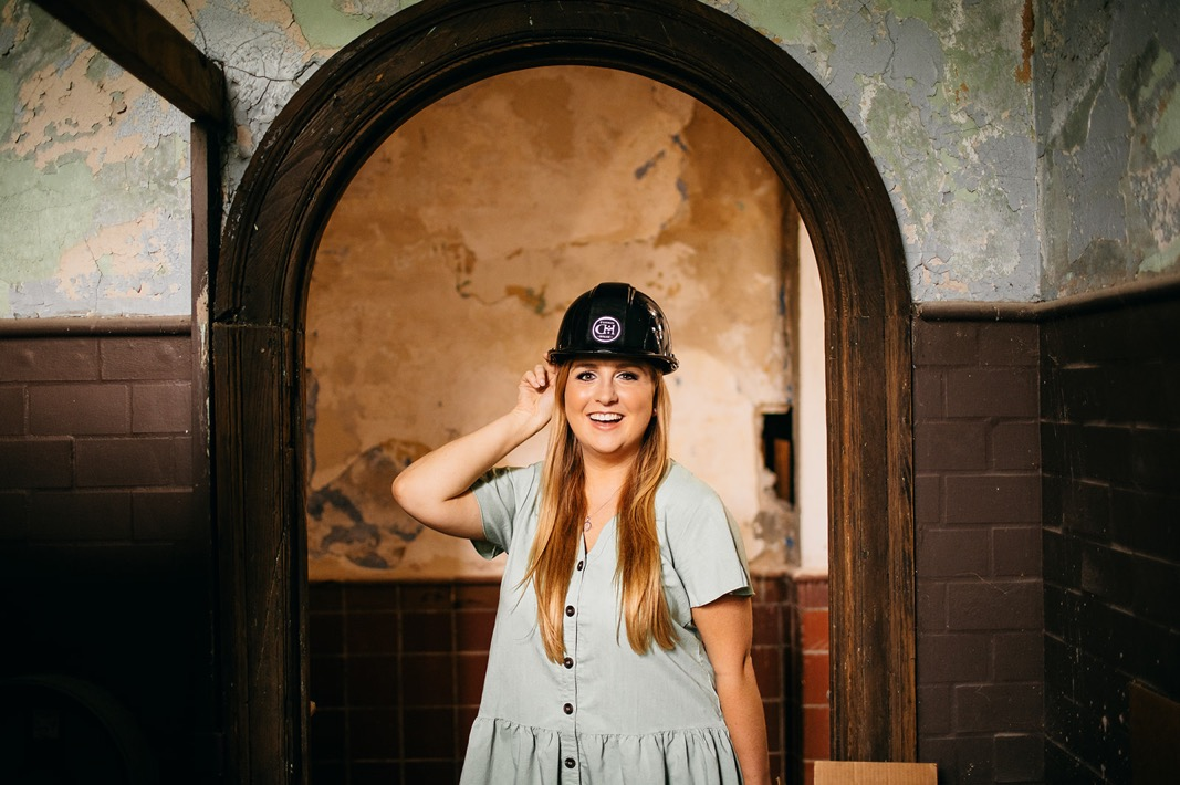 Rebecca Ellington, Director of Events at Common House Chattanooga, wearing a hard hat