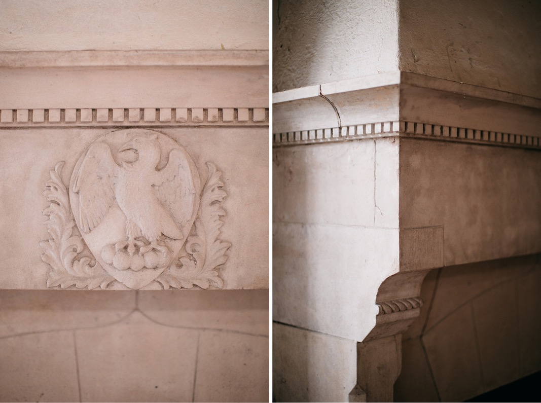 detailed carved white fireplace in Common House Chattanooga's Pennybacker Room