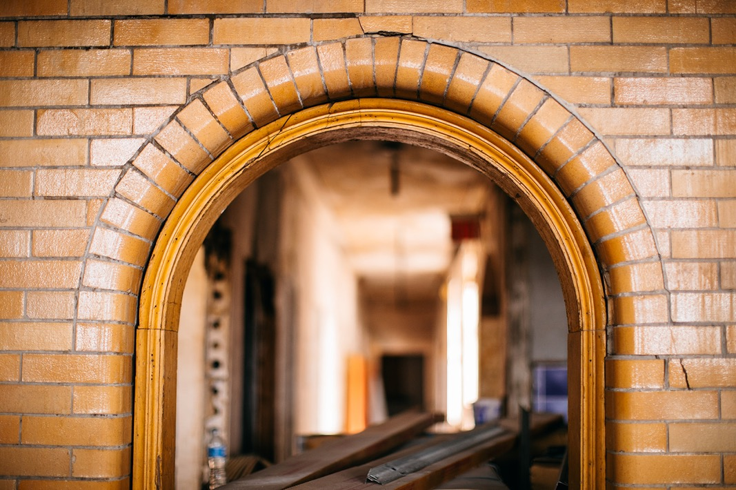small, arched doorway covered in a yellow brick of Ruby Hall