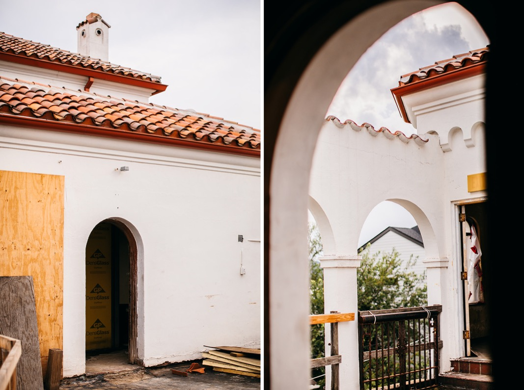 whitewashed archways and Spanish tile roof of Common House Chattanooga's rooftop patio