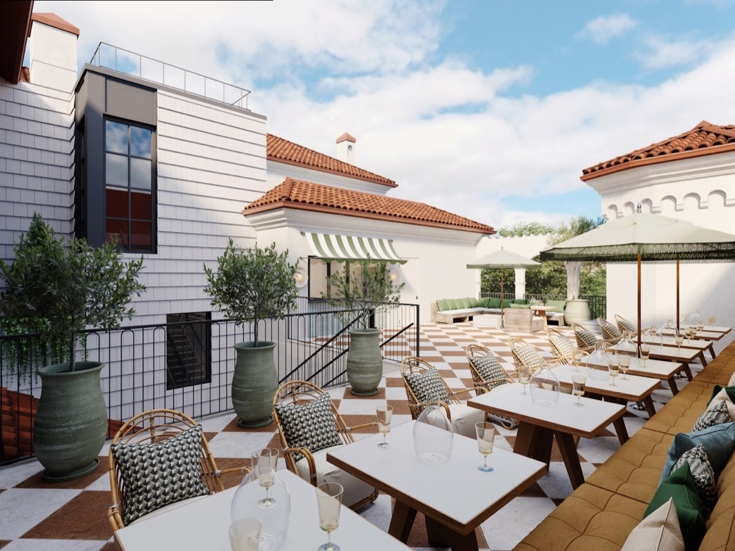 professional rendering of Common House Chattanooga's rooftop patio with whitewashed walls, Spanish tile roofs, bistro tables