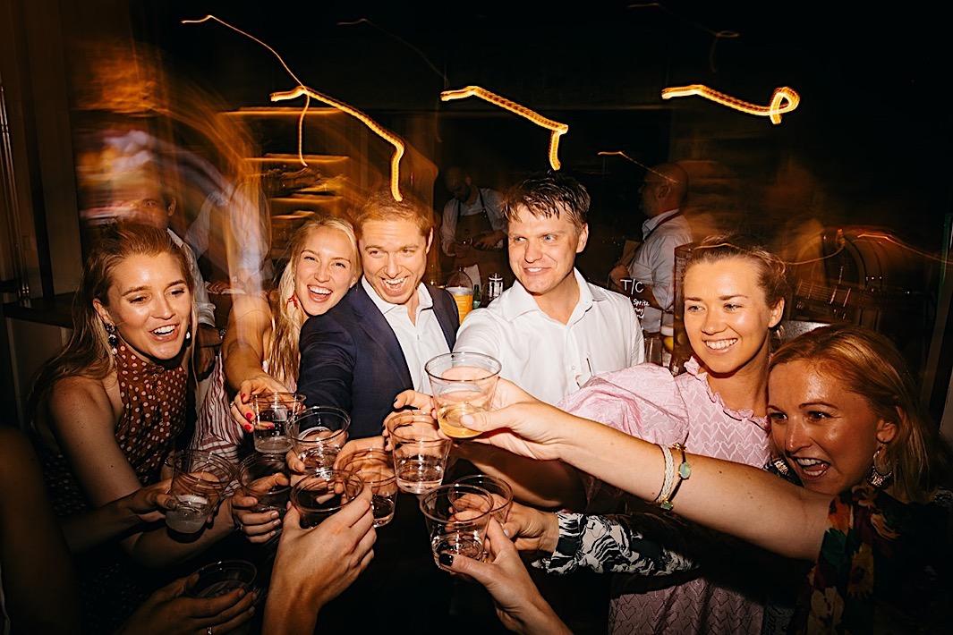Wedding guests cheers on the dancefloor.