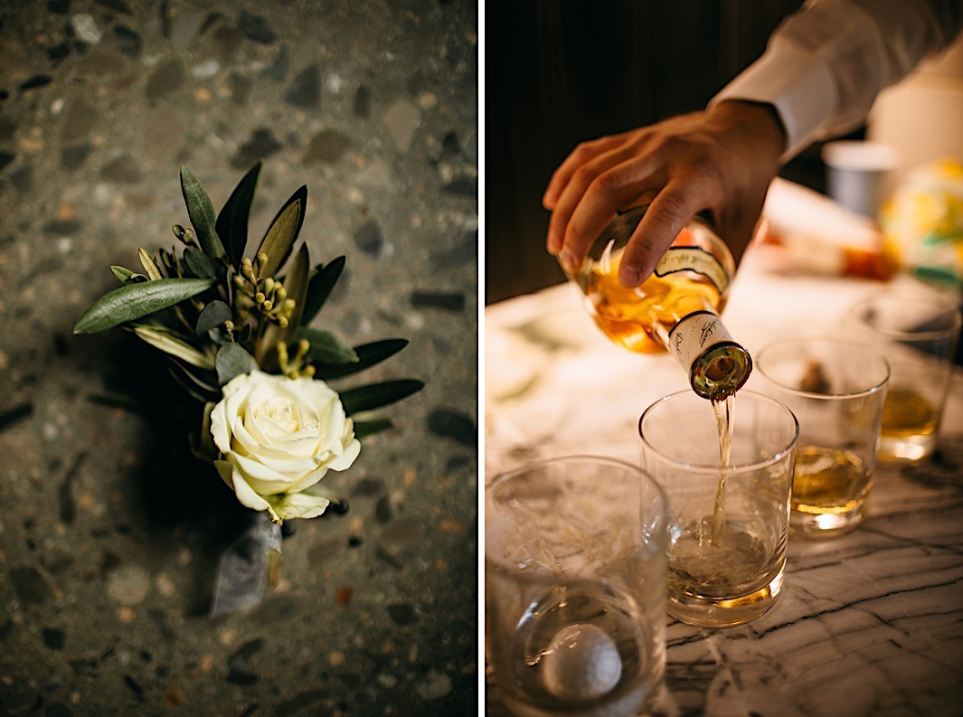 A groom pours whiskey into glasses.