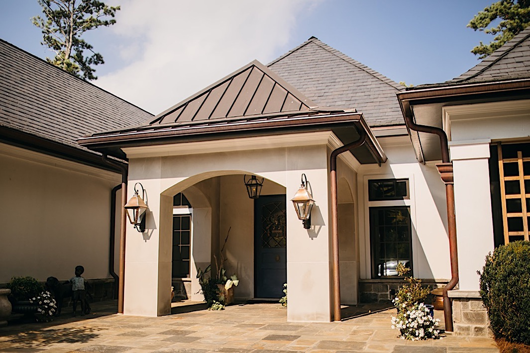 The facade of a family home and venue for a big backyard wedding.