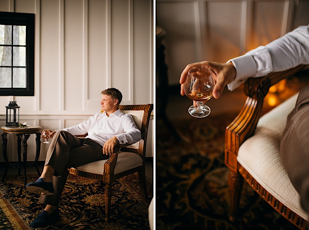 A groom lounges in an antique chair with a glass of whiskey in hand.